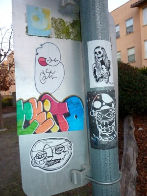 graffiti on pole on Stanford campus